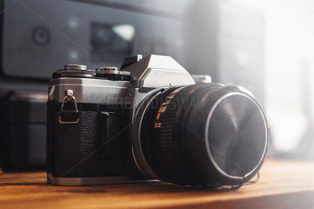 Old Film Camera on bright wood (100391)
