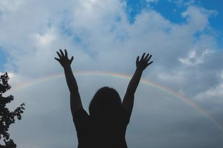 Raised Hands and Rainbow