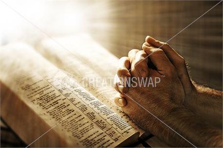 Man Praying over Bible (18109)