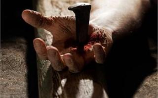 Nail pierced hand