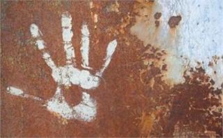 Rusty wall with handprint
