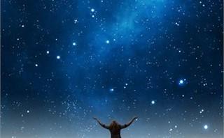 Woman praising under night sky