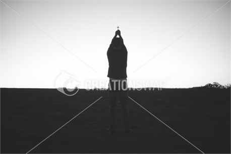 Man holding cross two hands (25204)