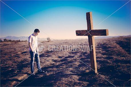 standing before cross (25236)