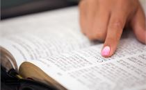 Girl Pointing to Bible Verse