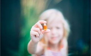 girl holding candy corn