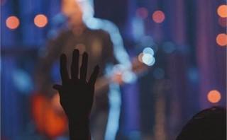 People raising hands & worship