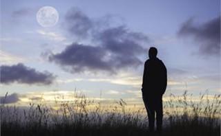 Man Staring at the Big Moon