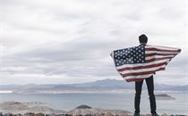 Holding an American flag