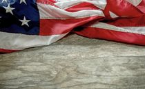 Flag across wood background