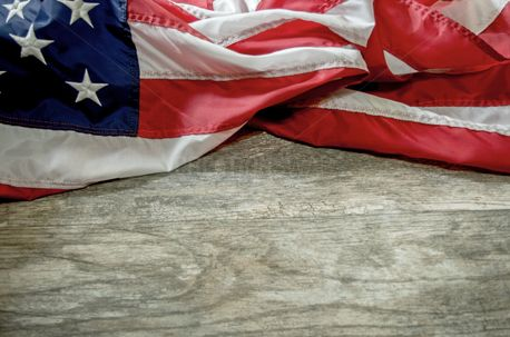 Flag across wood background (52334)