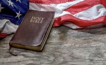 Holy Bible with US Flag
