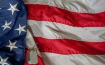 Dog tags on US Flag