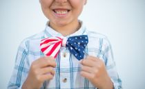 boy holding bow tie