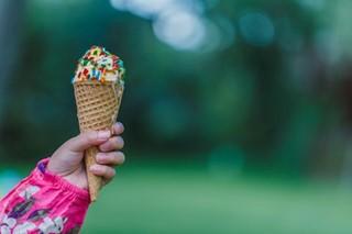 Girl eating cone ice cream