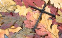 Nail Cross on Autumn Leaves