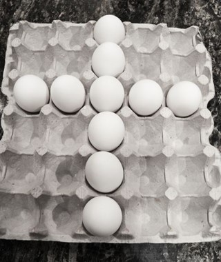Cross made of eggs