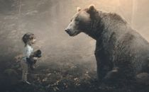 Little girl and big bear