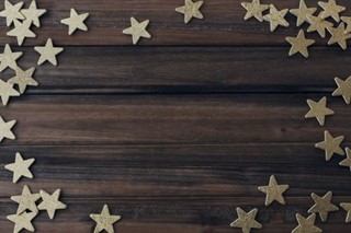 Gold Stars on wood Background