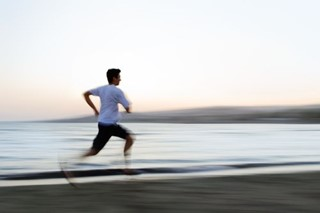 Man Running on Beach
