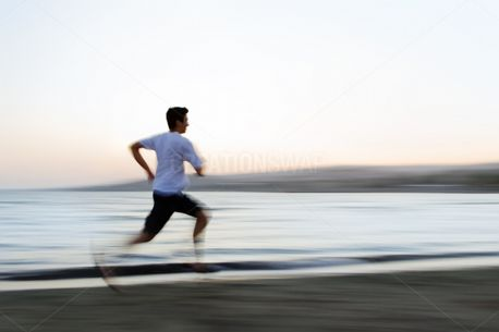 Man Running on Beach (63470)