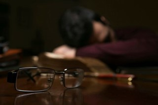 Man Tired after Reading