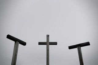 3 crosses in greyscale