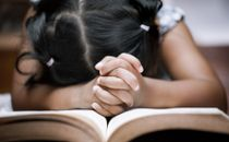 Little girl in prayer