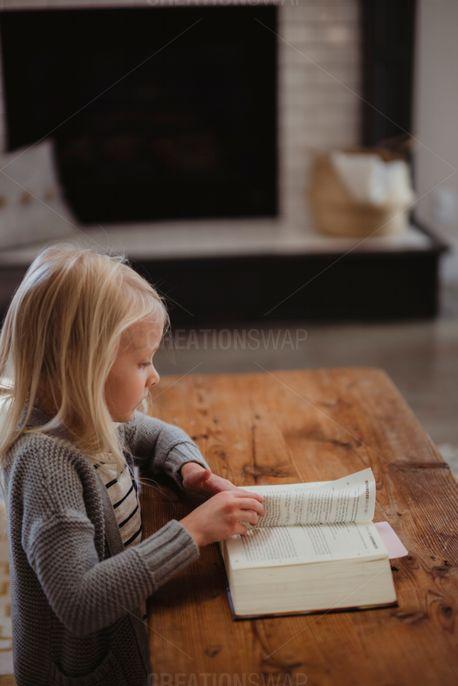 Girl reading her Bible (65853)