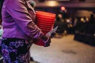 Woman with offering buckets