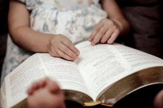 Closeup child with Holy Bible