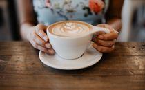Girl holding coffee mug