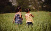 Little girls in field