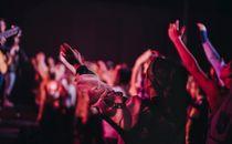 Teen raising hands in worship
