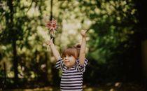 Child holding up pinwheel