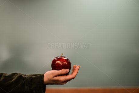 Hand Holding An Apple  (69920)