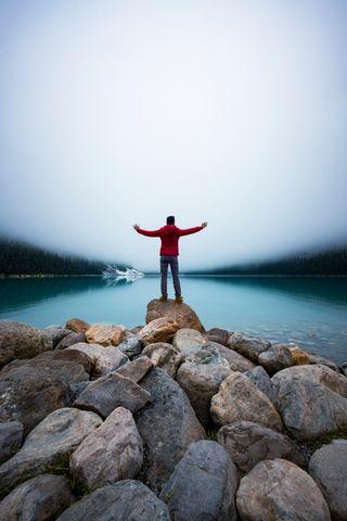 A tourist man enjoy Lake Louis