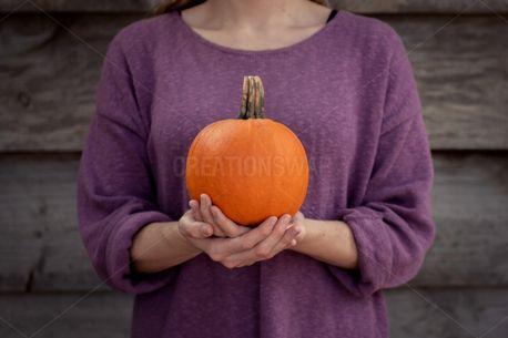 Holding Pumpkin (73249)