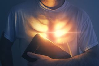Glowing heart and Bible
