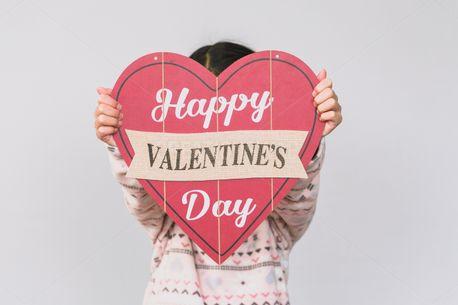 child holding a valentine sign (76086)