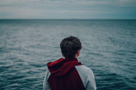 Man Looking at Ocean (77069)