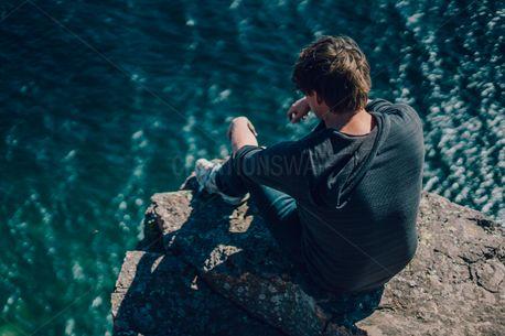 Man Looking at Ocean (77251)