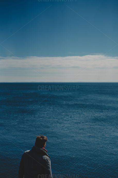 Man looking at water (77715)