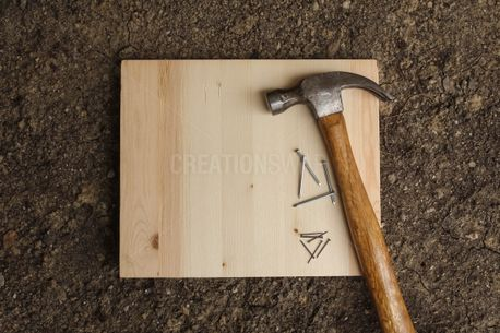 Hammer and nails on wood (78832)