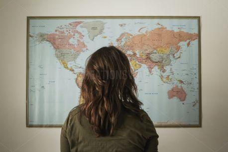 Woman Looking at World Map (79212)