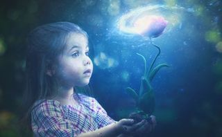 Little girl with glowing flowe