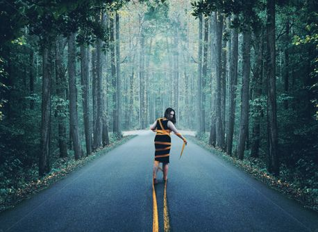 Woman caught in the road (79492)