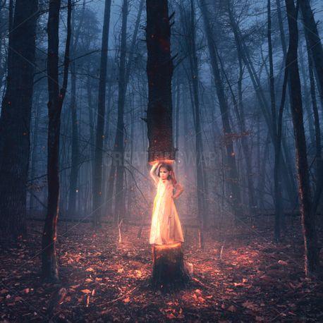 Little girl holds tree (79495)