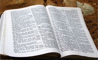 Open Bible on Rock