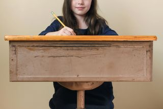 Girl Sitting At Desk